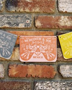 These save-the-dates by Metal Mermaid were designed to resemble traditional Mexican papel picado