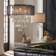 Industrial design with a contemporary crystal chandelier.