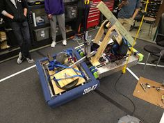 Day 8: MCCC and lifting prototypes continue   Lifting Prototypes  We purchased a lever chain hoist this morning so that we could test different lifting concepts without having a robot cable of lifting another just quite yet.  Keeping a partner level is definitly going to be a challenge. We are going to continue working on our retaining device as well to help hold our partners securely close to our bumpers. We do have tread on the two forks that we have under the partner robot as well.  The…
