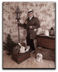 """Meet Me At Bugsy's Place"" Great Gatsby Photo Booth for rent in San Bernardino CA with complete mobile service to the entire USA, complete with Brick Wall Backdrop, Zoot-Suites, Flapper Dresses, Fedora Hats, Spats, Money Bags, Street Light Backdrop, Accessories and Tommy Guns!"