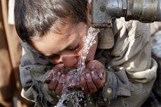 Boy drinking clean water.