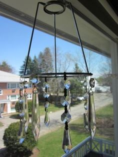 The top/base is the guts from an old lampshade, then hang whatever from it for a windchime.