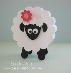 Punchart sheep holds a treat. if you don't have punches, you could also use popsicle sticks for legs and cupcake liners for the body and construction paper plain cardboard for the face & flower.