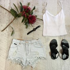 The summer staples no wardrobe should be without basic white cami ✔ high waisted denim shorts ✔ shop this look in store @harbourtowngc