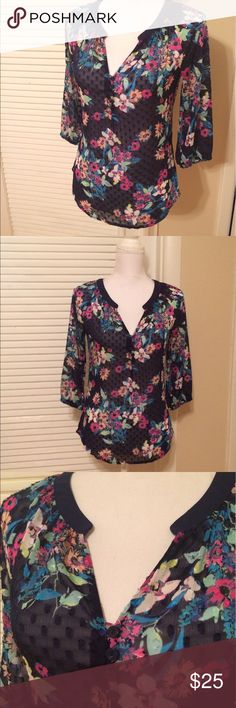 Navy floral top Gorgeous floral top.  Tunic style with split neck, curved hem, and 3/4 length sleeves.  Fabric is sheet with little dots (see close up pics).  Pretty floral print with navy background and flowers in mint, fuschia, aqua, and peach tones. 100% polyester,  size XS by Candies.  Worn twice,  EUC. Candie's Tops Tunics