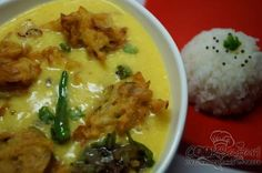 The crisp, golden-brown onion pakodas are added to this and allowed to soak. Punjabi Kadhi Pakoda can be served cold with hot rice.  http://goo.gl/xiNhWG
