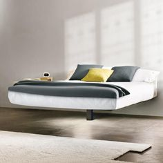 With the Fluttua bed, it will feel like you are sleeping on a cloud. Essential and functional, this suspended bed gives shape and lightness to dreams. Bed Frame Design, Sofa Bed Design, Room Design Bedroom, Bedroom Furniture Design, Steel Bed Design, Diy King Bed Frame, Floating Bed, Home Interior Design, Suspended Bed