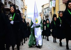 Penitents walk up Calle Balborraz during the Holy Week procession of the Cofradia de la Virgen de la Esperanza on April 5, 2012 in Zamora, Spain. Easter week is traditionally celebrated with processions in most Spanish towns. By Jasper Juinen/Getty Images.