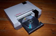 1GHz CPU, 256MB of RAM and a 40GB hard drive running game emulators for NES, SNES, N64 and PS2.