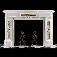 A substantial elegant Scottish George IV / Regency chimneypiece in white Statuary marble with inlaid panels of Africano Cippolino Onyx, diamond centerpanel motifs on the jambs and fluted and reeded ingrounds with pretty stylised floral Paterae in the top corners.Circa 1820 (Brave)