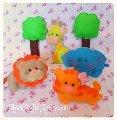 A cuddly lion, a giraffe very quaint, a lion king of the jungle and a elephant very clever. What do you think of these little friends?