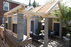 "Chunky cedar aerial features tie together the different zones of this outdoor living space.  This is an ""AFTER"" photo from a deck rescue featured on ""Disaster Decks"" resurfacing project ""The Deck Jenn Hates"". Deck design by Paul Lafrance Design."