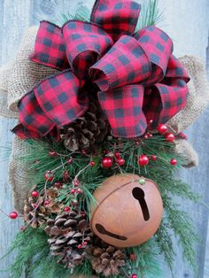 Sleigh bells with plaid bow, a Christmas door wreath