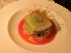 Steamed stone-bass fillet, stewed leeks, capers, tomatoes sauce