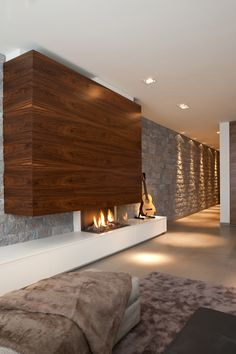 Mix of wood and stone always a winner with a #fireplace. Contemporary lines, warm materials.
