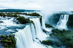 """The Igazu River splits Brazil and Argentina, just as the falls split the upper and lower portions of the mighty river. Iguazu Falls, which translates to """"big water,"""" is among the widest in the world and, like many other falls, associated with a legend. The story states that a deity was to marry a beautiful woman when she left him for a mortal. During their getaway in a canoe, the angry deity cut the river causing the waterfall that killed the lovers."""