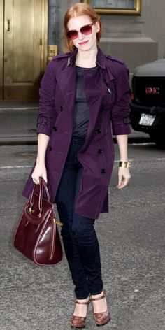 January 3, 2013  Jessica Chastain  WHAT SHE WORE  Jessica Chastain hit the street in a purple Burberry trench that she styled with a leather Alexander McQueen tote, gold Louis Vuitton bracelet, oversized shades and platform heels.