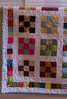Nine Patch a Day Quilt I  just love this colorful, simple quilt.