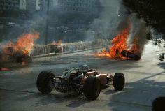 Chris Amon passes the wreckage of Bandini's Ferrari at Monaco 1967