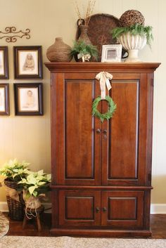 I am happy to finally share pictures of our home all decked out for Christmas. I LOVE this time of the year and wish I co. Armoire Decorating, Decorating Above Kitchen Cabinets, Tuscan Decorating, Decorating Ideas, Top Of Cabinets, Above Cabinets, Wood Cabinets, White Cabinets, Cupboards