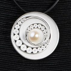 Here is the brand new Atom Pendant ! So beautiful silver pendant with a delicate pearl in the middle of it ! It will make happy women who are rather classical.