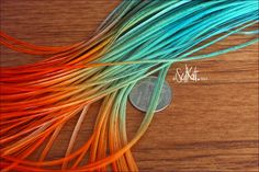 Teal and Orange Long Feather Hair Extensions Feathers for Hair, Tie Dyed, Solid Ombre Dipped Extension, QTY10 8-11inch. $12.50, via Etsy.