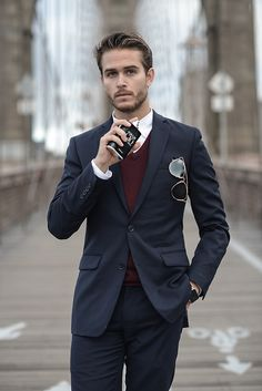 - with a fall dapper combo with a navy suit maroon v-neck sweater white button up shirt sunglasses cologne Mens Fashion Suits, Mens Suits, Terno Slim Fit, Armani Suits, Blue Suit Men, Hipster Looks, Hipster Guys, Style Masculin, Well Dressed Men