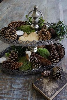 Nothing beats the simplicity of pine cones and moss and a few well placed tealights.