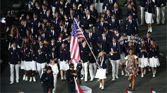 Mariel Zagunis of the USA Olympic team carries her country's flag during the Opening Ceremony of the London 2012 Olympic Games at the Olympic Stadium on 27 July 2012.