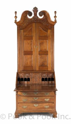 The William Barch, Lancaster, Pennsylvania Chippendale carved walnut desk and bookcase, signed by maker William Dennis and dated 1789,103 H. x 37 W.