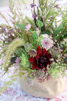 A bouquet of purple and green hues includes wild grasses, dahlias, masterwort, and chocolate Queen Anne's lace. Designer and author Charlotte Moss shares her lifelong love affair with wildflowers here and in her new book, Garden Inspirations (Rizzoli New York, 2015)