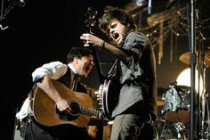 Marcus Mumford and Country Winston Marshall of Mumford & Sons perform at the 22nd Annual KROQ Almost Acoustic Christmas Concert