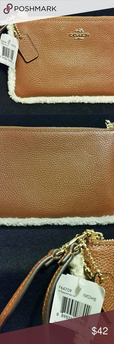 COACH LEATHER & SHEARLING WRISTLET STYLE #F64709 NWT Unique COACH wristlet saddle/camel leather with shearling trim. Zip closure. Strap with clip to form wrist strap or attach to inside of a handbag. Two slots for credit cards. Slightly larger than typical Coach wristlet and will fit most cell phones. Box for display purposes only. Start your holiday shopping early. This will make a great gift!! Coach Bags Clutches & Wristlets