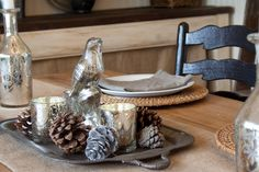 Corral favorite objects on a tray. Choose items in a tight color palette for a collection that hangs together. Silver paired with mercury glass, and white with wood, are two foolproof combinations: The Old Painted Cottage