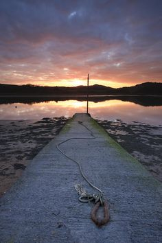 Sunset over River Urr with an old jetty at Kippford, Dumfries n Galloway, Scotland_ UK