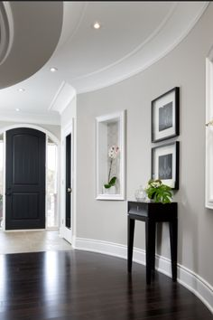 Black painted doors are so styling these days. Blended beautifully with the light paint colour on walls and paired with dark furniture and accessories makes this a gorgeous entryway/foyer www.pgpaintanddesign.com for all your house painting in Ottawa, ON.                                                                                                                                                      More