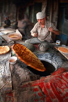 Baking naan bread . Kuqa, Uyghur Autonomous Region, China