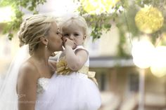#nancyavon from www.bit.ly/jomfacial Sharing a light moment with your love dear! Bride with child by AMRfoto
