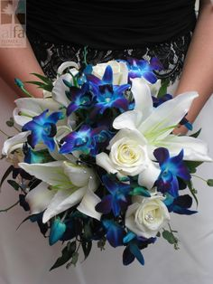 A gorgeous bridal bouquet with white casablanca lilies and blue bomb orchids
