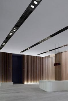 Imagine this track-inspired take on recessed lighting in a gallery space. Modern and theatre-esque! (Interior of the Bao'an Stadium in Shenzen by Gmp Architekten (photo by Christian Gahl) Lobby Interior, Office Interior Design, Office Interiors, Interior Lighting, Lighting Design, Interior Architecture, Lighting Ideas, Office Ceiling Design, Modern Recessed Lighting
