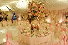 white wedding Drapery, pink chair ties, pink flower centerpiece