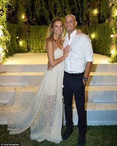 Magical moment: Bar Refaeli has shared a beautiful picture of her incredible wedding dress after tying the knot with businessman Adi Ezra