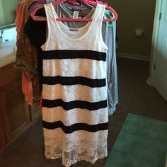 Pretty white with black stripe lace dress Very pretty feminine dress for spring and summer. White lace detail with black stripes and black lace bottom. Fits very true to size and very comfortable. Made in the USA 100% polyester.  15% off bundles and I ship FAST! Boutique Dresses