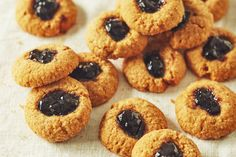 Graham Cracker Thumbprint Cookies Recipe. The Best, soft, chewy, cookies, topped with your favorite jam. This easy twist on a classic holiday Christmas cookie is a great addition to your yearly cookie plate ideas and recipes! Try it this holiday season with your kids.