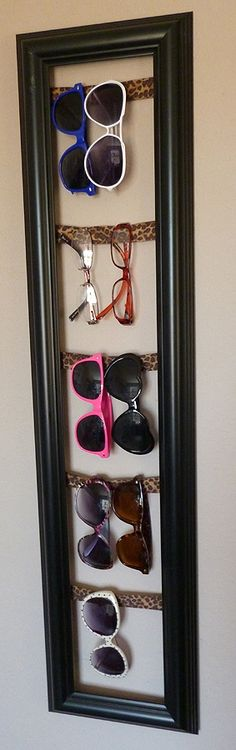Looking for a cool way to store your sunglasses? Try using an old picture frame. Just hang 2 - 3 rows of string, cloth, or wire across the back and hang it up by your front door.