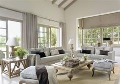 A house filled with light and white, cream and grey taupe shades. Large rooms and windows, which can be opened up to get the light and warm weather in. A place where the outdoors also play an important role - and it shows in the beautiful covered seating and dining areas outside.    This house is like a little piece of paradise, so cozy and casual chic with a coordinated manner which flows from one room to another. Just so lovely!