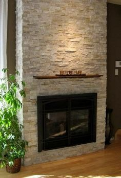 small mantle above, black framed fireplace home-decorating