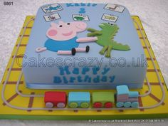 George Pig Cake. George pig and his favourite toy Mr Dinosaur from Peppa Pig. A classic popular scene from George's bedroom including a handmade toy train around the sides and posters on the wall