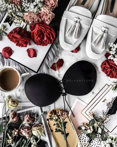 Fashion flatlay with flowers and stick-on bra • Photo by Olivia Eleazar | @Elkantlers on Instagram