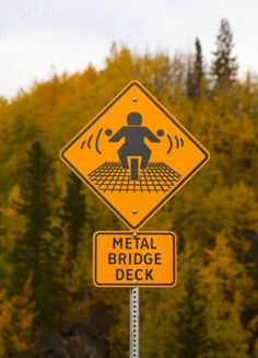Hate it when that happens! Metal Bridge Deck warning sign for motorcycles, British Columbia, Canada